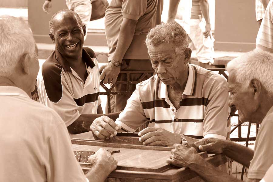 Group of men playing dominoes on the street in Santiago De Cuba, Cuba