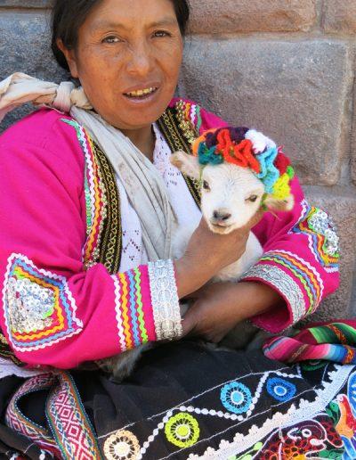 Lady holding lamb Cuzco Peru