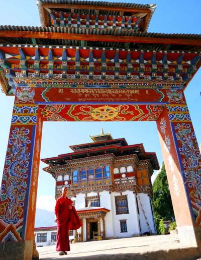Monk at entrance to Monastery Bhutan