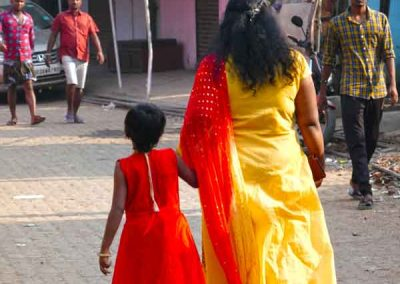 Mother and daughter hand in hand