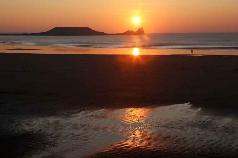 Sunsetting behind Worm's Head