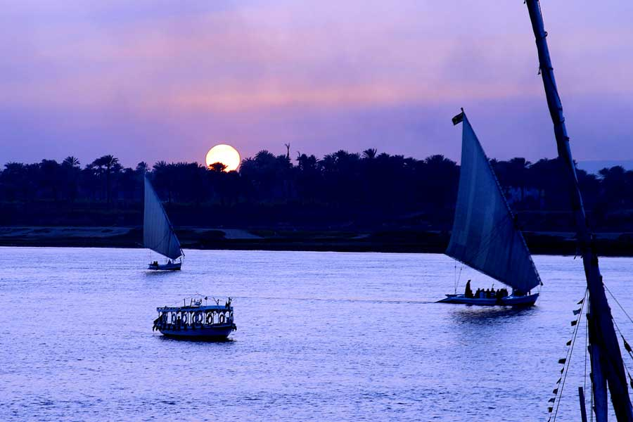 Felucca's at sunset on the Nile Luxor Egypt