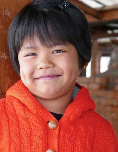 Girl at weekend market Thimpu Bhutan