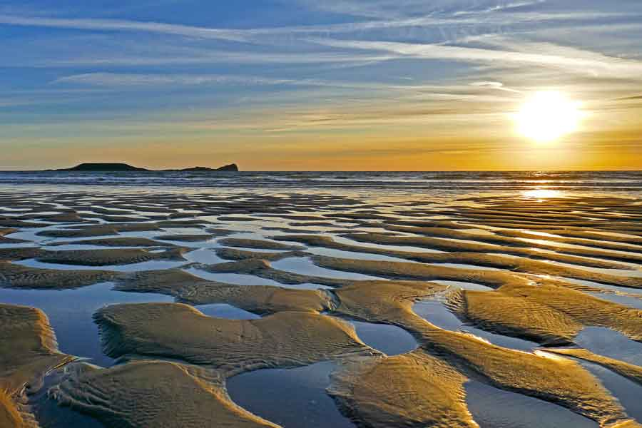 Sunset across the sweeping sands of Rhossili Beach