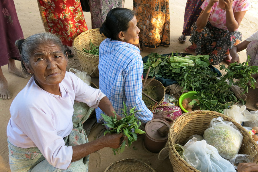 Group of ladies bartering for supplies in a village near Bagan Myanmar