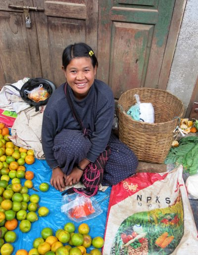 Young girl selling fruit in a market Myanmar
