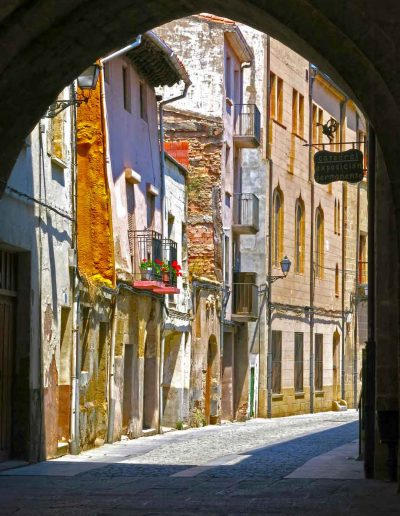 Coloured houses through archway Spain