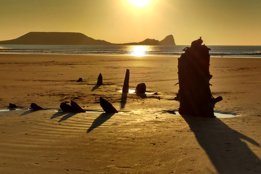 Worms Head and the wreck of the Helvetia at sunse